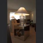 Bespoke-stainless-steel-table-with-Ralph-Loren-lamp