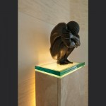 Bronze-sculpture-on-limestone-plinth