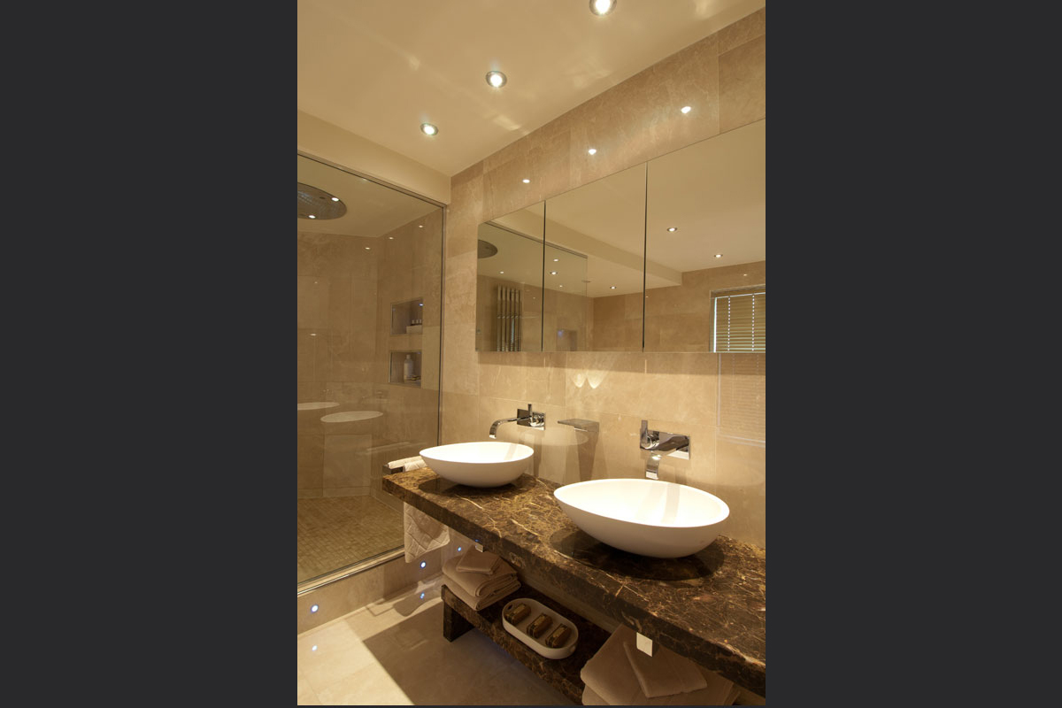 Lime-stone-bathroom-with-his-and-hers-sinks