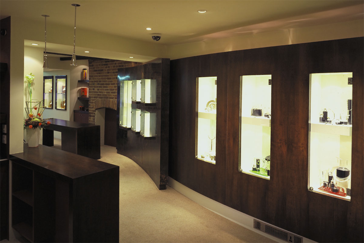Galio-Jewelers-curved-cherry-wall-and-curved-copper-wall-with-canterlevered-display-cabinets