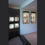 Galio-Jewelers-curved-copper-wall-with-canterlevered-glass-display-cabinets
