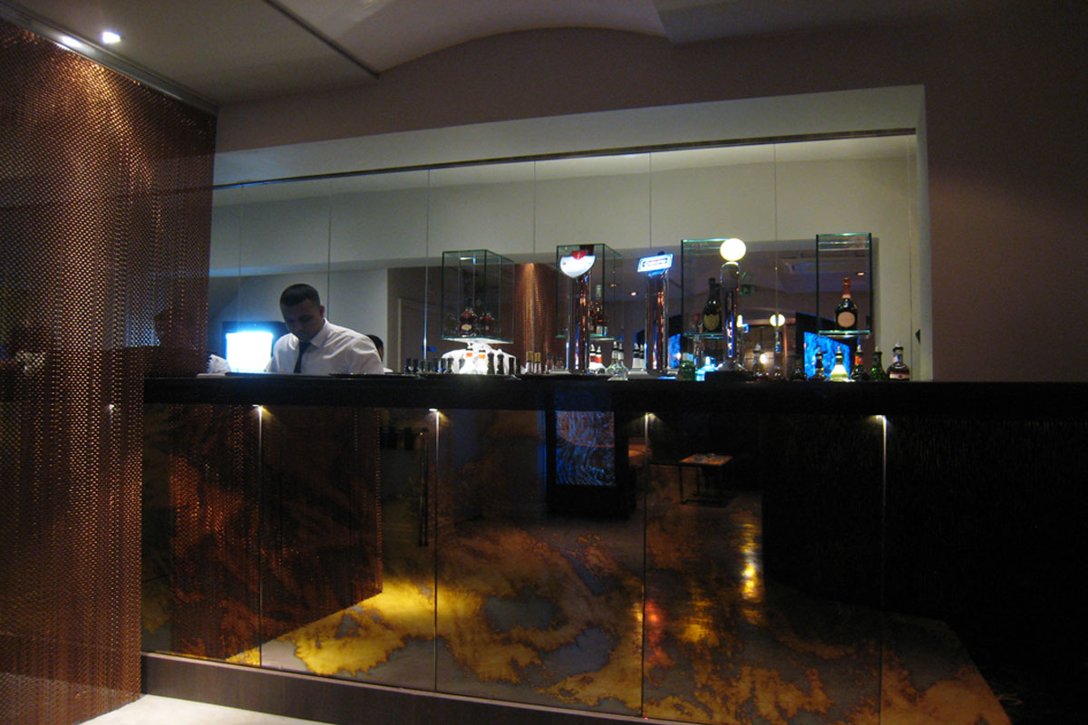 bar-with-bronze-chain-metal-curtain-and-distressed-gold-glass-panels.jpg - Holdi Restaurant Commercial Gallery - Definitive1 Interior Design