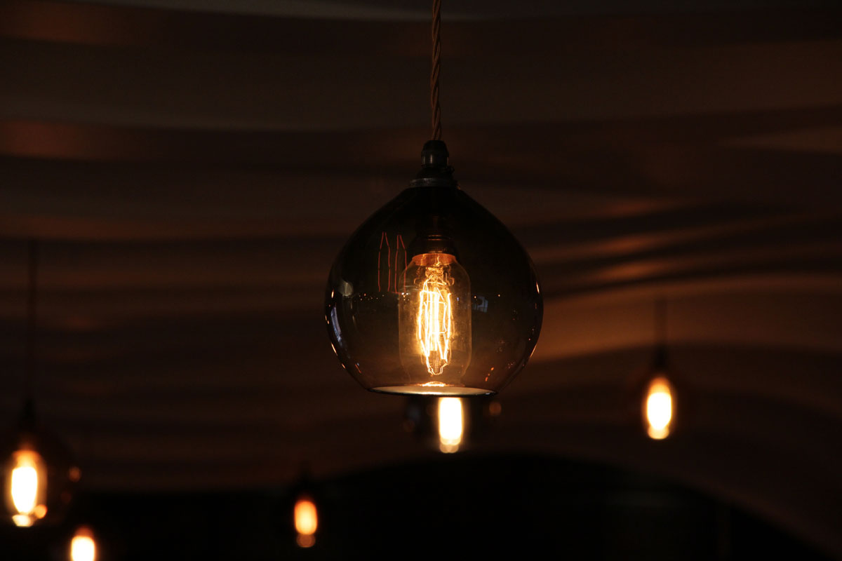 detail-of-hand-blown-lamp-with-rabit-cage-light-bulb.jpg - Holdi Restaurant Commercial Gallery - Definitive1 Interior Design